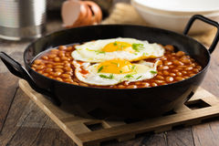 Baked Beans with fried eggs and chives Stock Photography