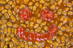 Baked beans with ketchup smile Stock Photos