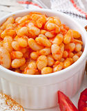 Baked beans in a mild tomato sauce Stock Photo