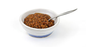 Baked beans in old bowl with spoon Stock Photography