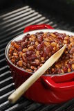 Baked beans on red stew on the grill Stock Photos