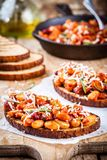 Baked beans with rosemary and parmesan on toast Royalty Free Stock Photo