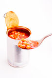 Baked beans with spoon. Baked beans spooned from an open can royalty free stock image