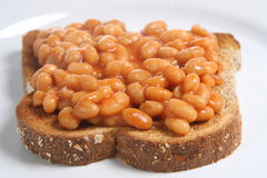 Baked Beans on Toast. Baked beans in tomato sauce on a slice of wholemeal toast Royalty Free Stock Image