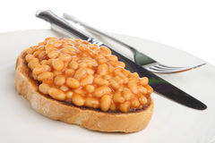Baked Beans on Toast. Baked beans in tomato sauce on toast Royalty Free Stock Image