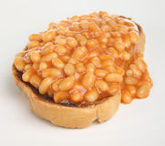 Baked Beans on Toast. Baked beans in tomato sauce on a slice of crusty toast Royalty Free Stock Images