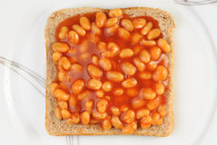 Baked Beans on Toast. Served on plate. Overhead view Royalty Free Stock Photos