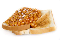 Baked beans on toasts Stock Images