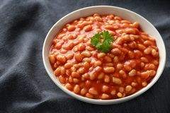 Baked beans in tomato sauce in white bowl.  royalty free stock photos