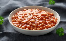 Baked beans in tomato sauce in white bowl.  royalty free stock photo