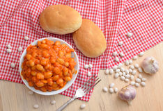 Baked beans with tomatoes and garlik Stock Photo