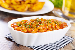 Baked Beans. Baked white beans with tomato sauce and parsley Royalty Free Stock Photo