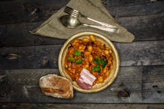 Baked beans. On wooden boards Royalty Free Stock Image
