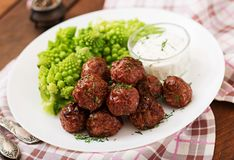 Baked beef meatballs and garnish from boiled cabbage romanesko Stock Photos