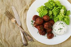 Baked beef meatballs and garnish from boiled cabbage romanesko Royalty Free Stock Photo