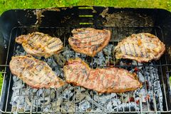 Baked beef and pork meat on grill Stock Photo