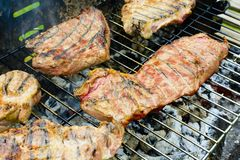 Baked beef and pork meat on grill Royalty Free Stock Image