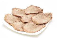 Baked beef tongue sliced. Stock Photos