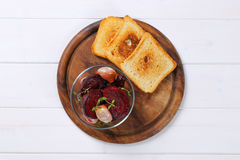 Baked beetroot with garlic and toasts Royalty Free Stock Images