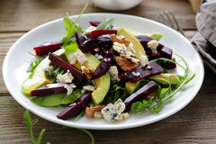 Baked beetroot salad with blue cheese and avocado Stock Photos