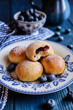 Baked blueberry buns. Fresh baked buns filled with blueberry jam stock photos