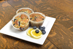 Baked blueberry and lemon muffins. Stock Photos