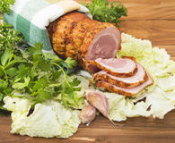 Baked boiled pork with greenery Royalty Free Stock Image