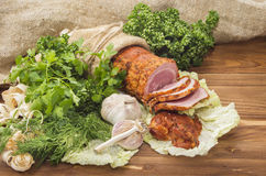 Baked boiled pork with greenery Royalty Free Stock Photos