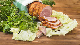 Baked boiled pork with greenery Royalty Free Stock Images