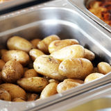 Baked or boiled potatoes in metal dish Royalty Free Stock Image