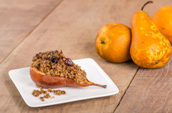 Baked bosc pear with crumble topping Royalty Free Stock Photos