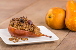Baked bosc pear with crumble topping Royalty Free Stock Image