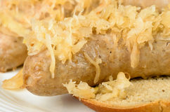 Baked bratwurst with sauerkraut Stock Images