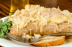 Baked bratwurst with sauerkraut Stock Photos