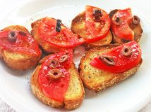 Baked bread with greek olive oil tomatoes and olives - appetizer at a greek restaurant Royalty Free Stock Photography