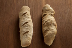 Baked bread loaf on wood Stock Images