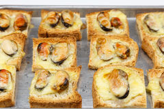 Baked bread with mussel and cheese Stock Images
