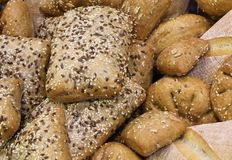 Bread pieces made with whole wheat flour and seeds and cereals. Baked bread pieces made with whole wheat flour and seeds and cereals above Stock Image