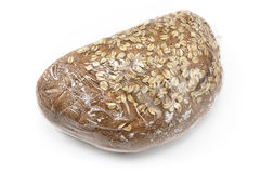 Baked bread with seeds wrapped in cellophane Stock Photos