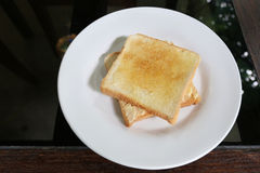 Baked bread on white dish. Stock Photos