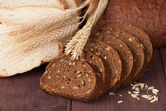 Baked bread on wood table. Royalty Free Stock Photos