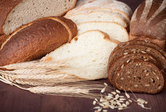 Baked bread on wood table. Royalty Free Stock Image