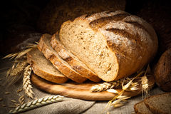 Baked bread on wooden table Royalty Free Stock Images