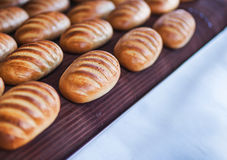 Baked Breads on the production line at the bakery Royalty Free Stock Photo