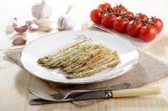 Baked breen asparagus on a plate Stock Photos