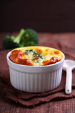 Baked broccoli souffle. In a green dish Stock Photos