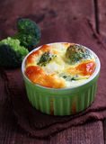 Baked broccoli souffle. In a green dish Stock Images
