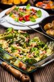 Baked broccoli with tomato salad Stock Image