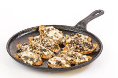 Baked Bruschetta in Flat Iron Skillet Royalty Free Stock Photo