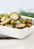Baked brussels sprouts and parsnips Stock Photo